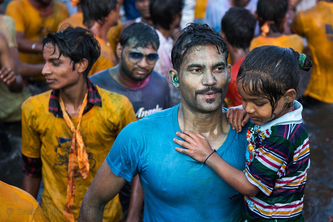 A man and his daughter during immersion of Ganesh idols in the Yamuna River for the Ganesh Chaturthi festival, Delhi, India