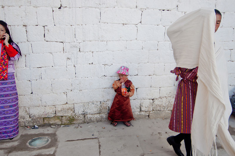This photograph of a kid waiting for her parents was shot during the Thimphu festival