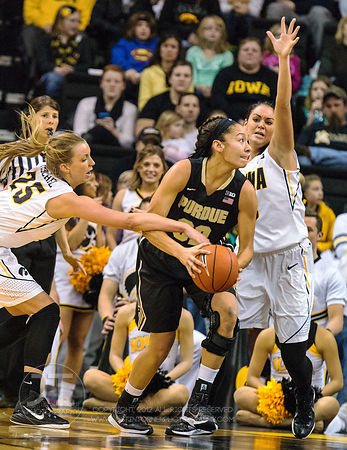Iowa's Kali Peschel (25) and Claire Till (3) defend Purdue's Whitney Bays (32) during the second half of play at Carver-Hawke...