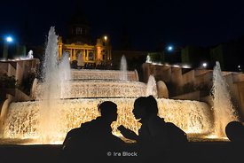 Tourists at the light and water show at the The Magic Fountain of Montjuïc (Font màgica de Montjuïc) in Barcelona, Spain.