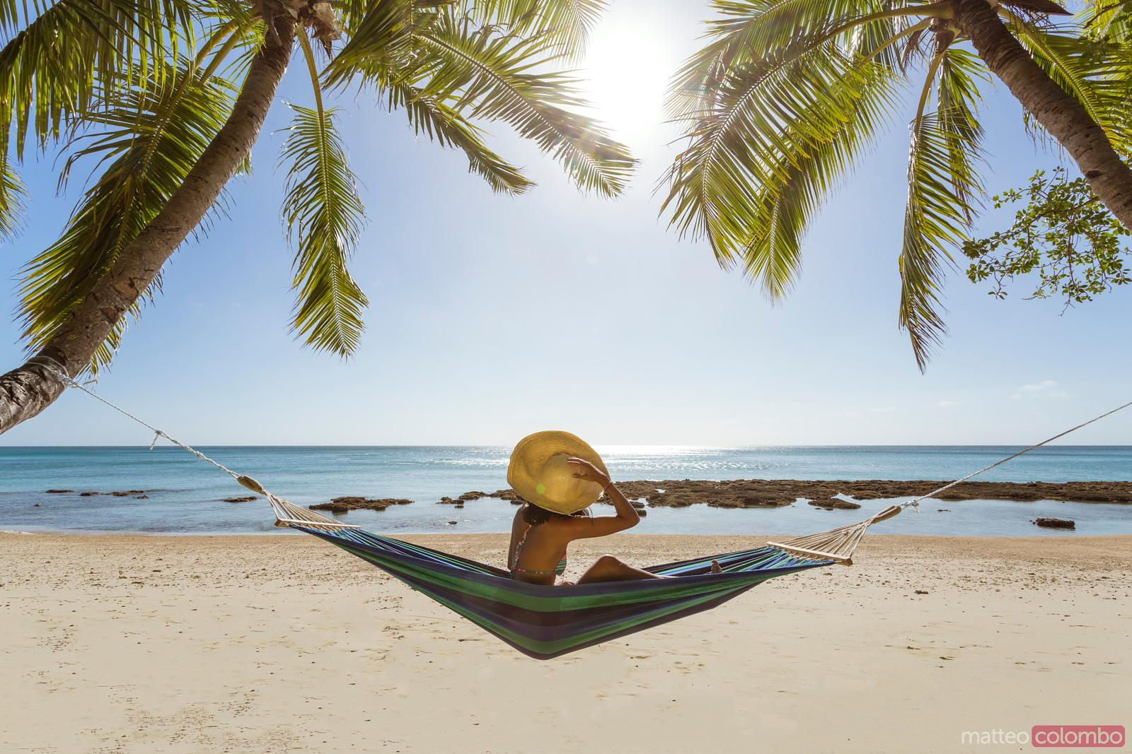 Woman At Beach Under Palm Tree Royalty Free Stock Image