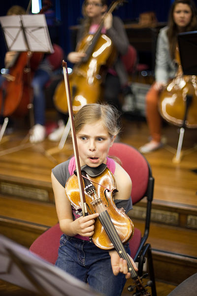 UK - Scunthorpe - A young musicians, part of the Youth Concert Band pulls faces during rehearsals of Cycle Song at the John L...