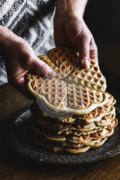 DELICIOUS HOMEMADE  WAFFLES ON A WOODEN TABLE