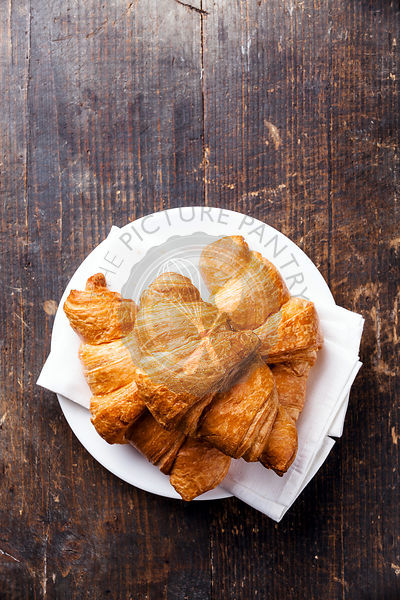 Croissants on wooden background