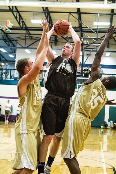 Iowa's Kyle Meyer attempts a shot under pressure during Primetime League play at the North Liberty Recreation Center on Sunda...