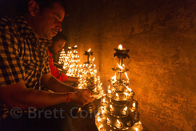 Men prepare candleabras for the Ganga Aarti, Dashashwamedh Ghat, Varanasi, India