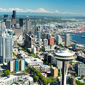 Seattle skyline and waterfront, Space Needle, and Mount Rainier; Seattle, WA
