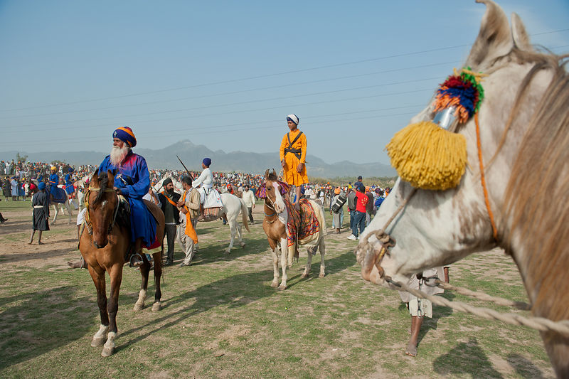A group of nihangs get ready with their horses for the games during the Holla mohalla festival