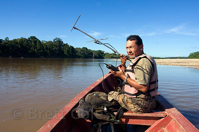 Member of the WWF AREAS Amazonia team on the Tambopata River, Peruvian Amazon