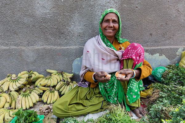 Woman Selling Vegetables at Outdoor Market