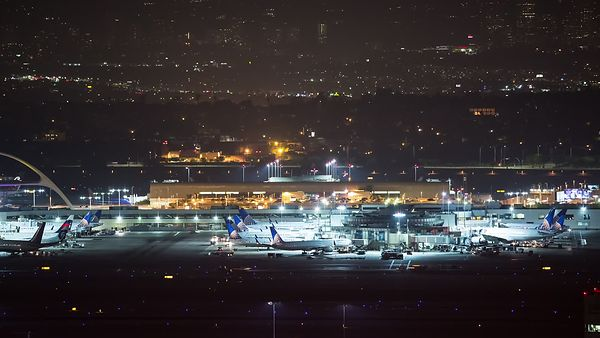Close Up: Busy Parked Gates, LAX Tarmac At Night