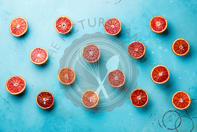Citrus fruit pattern of fresh red orange slice on blue background