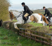 Martin Reason jumping a hedge on Deane Bank