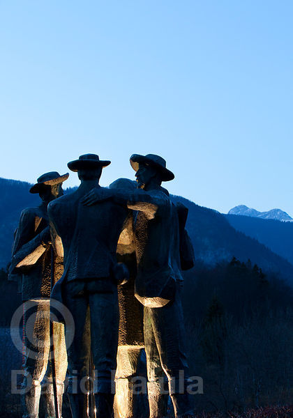 Monument to the first climbers of Triglav (1778) Lovrenc Willomitzer, Luka Korosec, Stefan Rozic and Matija Kos. with the Slovenian National Mountain highest peack on the background
