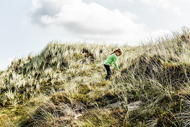 Danish girl playing in the dunes in Thy 10
