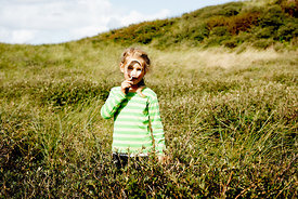 Girl with magnifying glass in Danish dunes 5