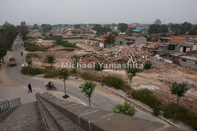 "Liaocheng, Shandong. Panorama of the oldest part of the city on Nangyuan Island has been torn down to be rebuilt as an, ""old ..."