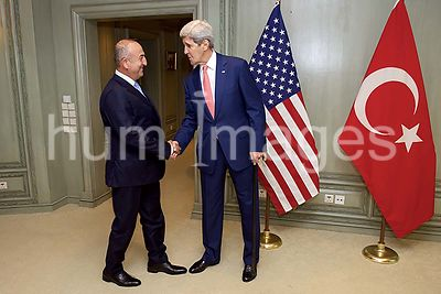 Secretary Kerry Greets Turkish Foreign Minister Cavusoglu Before Meeting Amid ASEAN Ministerial Gathering in Malaysia