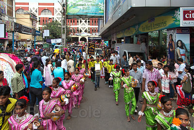 Children march in a parade during the Durga Puja festival, Newmarket, Taltala, Kolkata, India