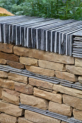 Detail of york stone and slate drystone wall in The Art of Yorkshire Garden designed by Gillespies at the RHS Chelsea Flower ...