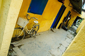 Bike Parked in Yellow Home Entry