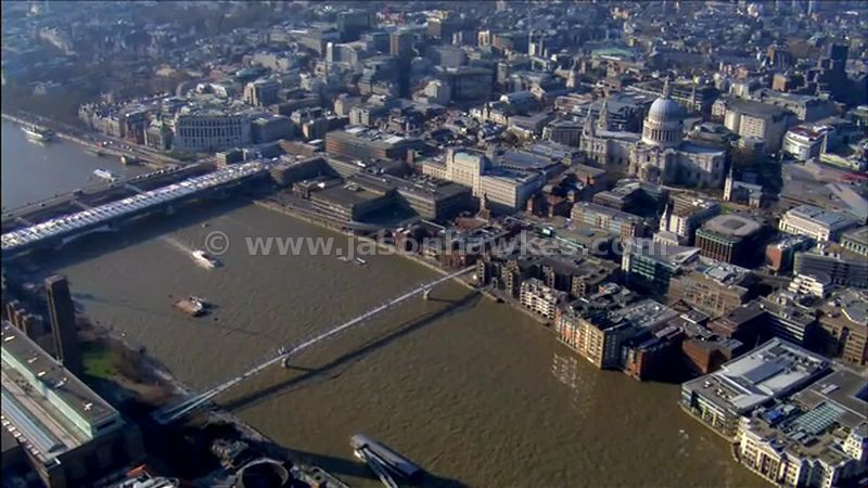 Aerial footage over the River Thames with the Tate Modern and St Paul's Cathedral, London, England, UK
