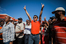 Madagascar's President Andry Rajoelina greets supporters of his political party at a rally for TGV (Tanora malaGasy Vonona) i...