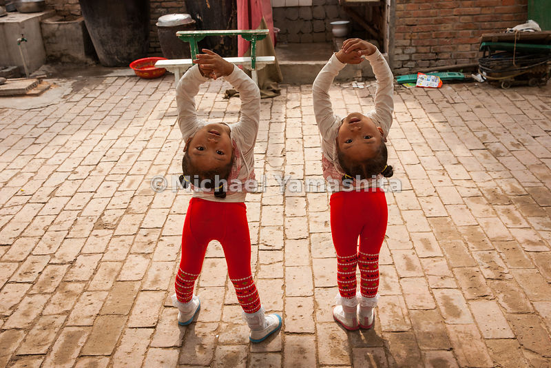 Three-year-old twins are among the youngest students at the Changfa Acrobatic School in Wuqiao County. Their program includes...