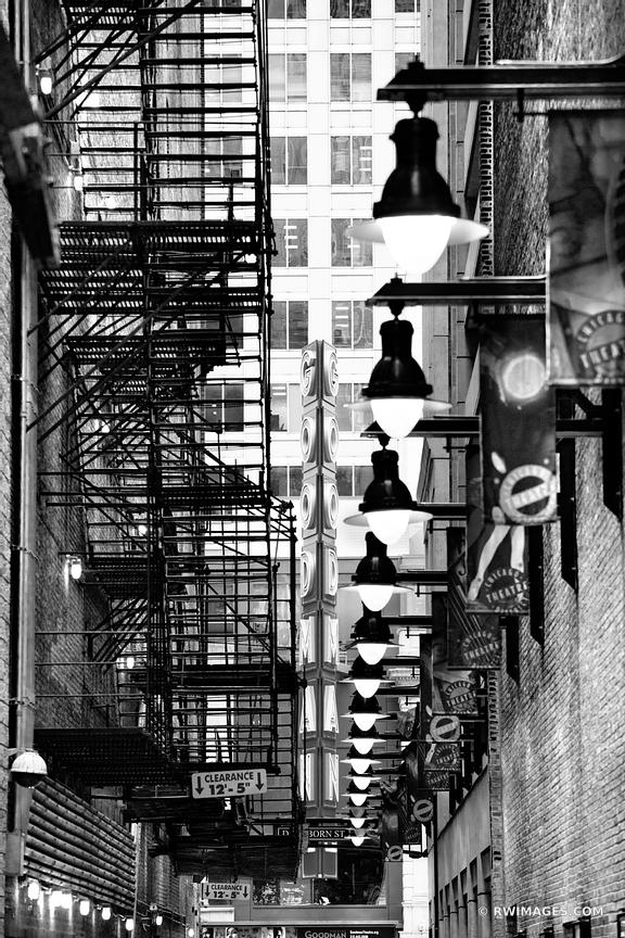 DOWNTOWN ALLEY GOODMAN THEATRE NEON SIGN CHICAGO ILLINOIS BLACK AND WHITE VERTICAL