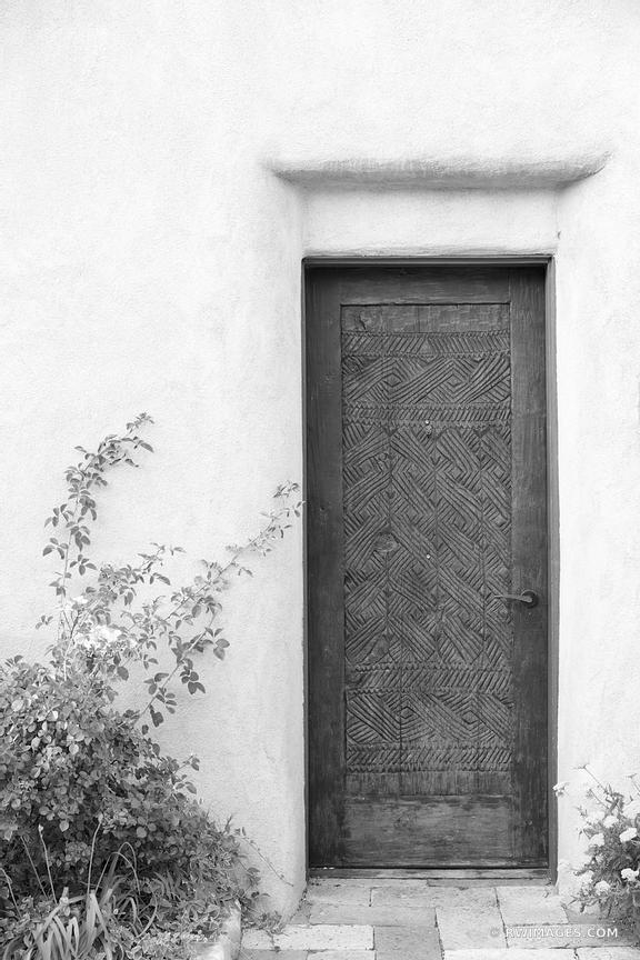 DOOR ADOBE WALL SANTA FE NEW MEXICO BLACK AND WHITE VERTICAL
