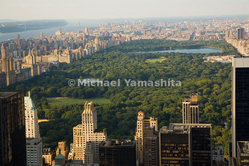 The view from Central Park South extends from the Sheep Meadow, past the Jacqueline Onassis Reservoir, and beyond the park's ...