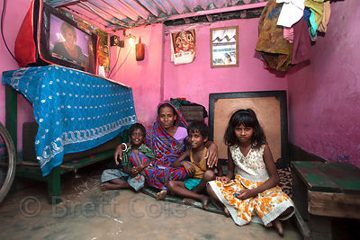 Portrait of a family in a slum area in Taratala, Kolkata, India, in an area served by PATH Welfare Society. If Westerners thi...