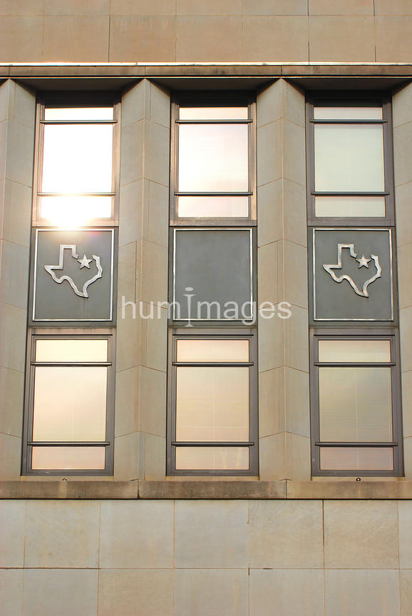 Windows with Texas state shape underneath them