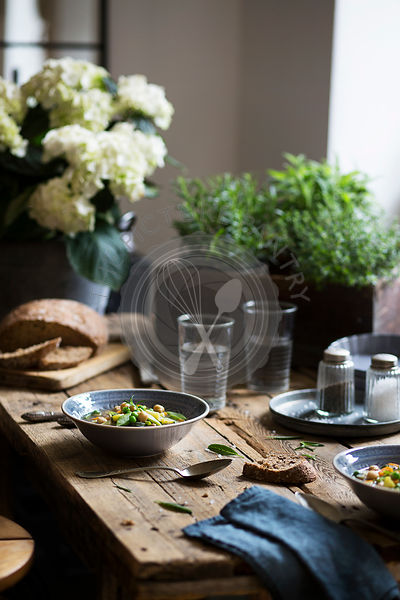 Rustic table in a country house with two soup dishes