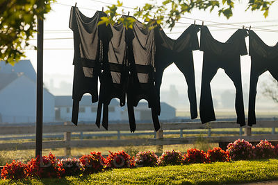 Black men's outifts hanging on a laundry line, Amish country, Lancaster, Pennsylvania