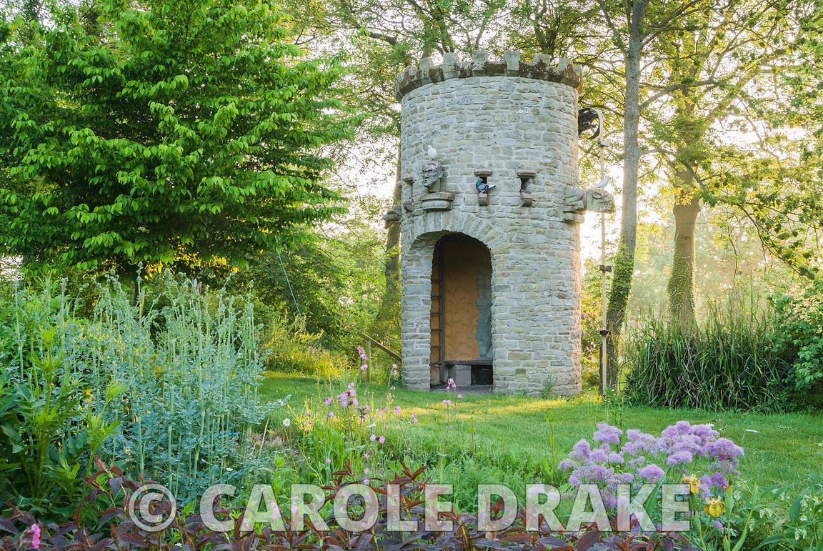 Stone dovecot that operates as a spectacular water feature as well. A simple belt and trough system scoops water up from the ...