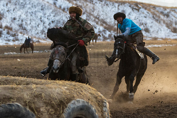 Kyrgyz Horsemen Playing Kok-boru at Sunset