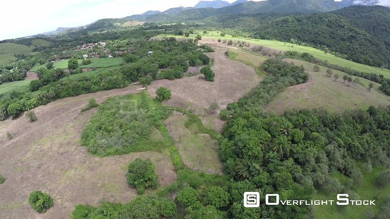 Aerial shot over an area of the Atlantic Forest, showing agricultural encroachment, Reserva Ecologica de Guapiacu, Rio de Jan...