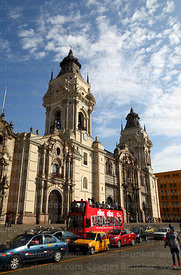 Ellos & Ellas magazine open topped double decker bus in front of cathedral, Lima, Peru