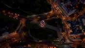 Aerial footage over Hyde Park Corner at night, Westminster, London, England, UK
