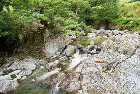 Fast flowing clear water of Galleny Force near Stonethwaite in the English Lake District.