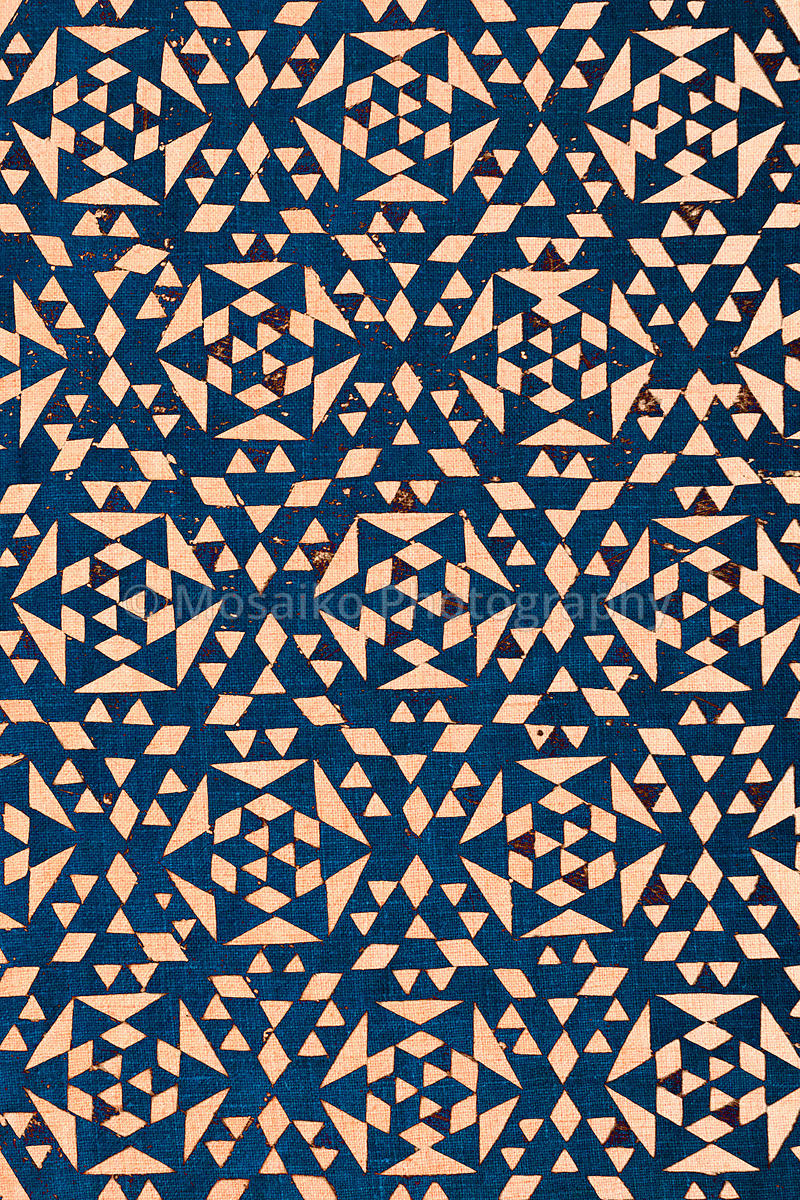 close up of blue tradtional design printed on textured cotton - abstract fashion background