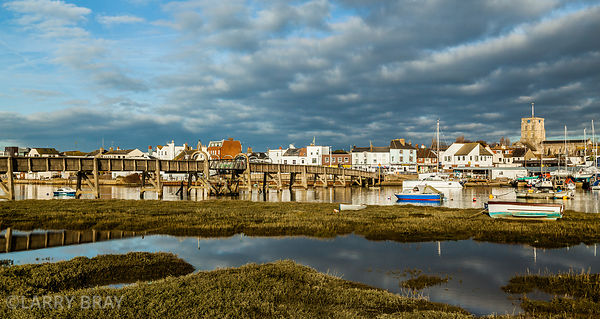 View across Adur river  to old footbridge and St Mary's church in Shoreham-by-Sea, West Sussex, UK