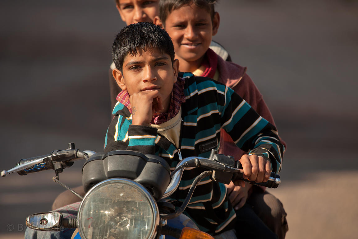 Boys riding a motorcycle, Jodhpur, Rajasthan, India