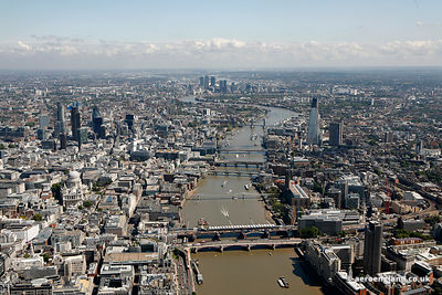 aerial photograph of the the River Thames London England UK showing the Thames bridges starting with Blackfriars Bridge behin...