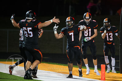 Solon's Coal Flansburg (7) celebrates a touchdwon catch with teammates Tyler Linderbaum (65) and AJ Coons (81) during the fir...
