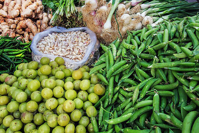 Mutter (peas) for sale at a vegetable market in Delhi, India