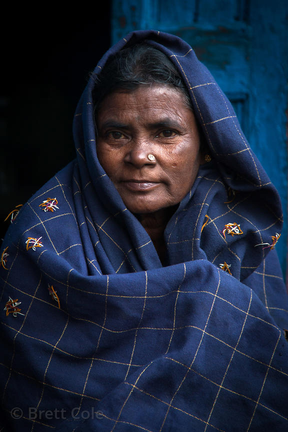 Portrait of a woman in blue in the Fakir Bagan neigborhood of Howrah, India, in an area served by the NGO Calcutta Kids (calc...
