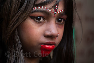 A girl in makeup, perhaps to resemble Kali, during a festival in Pushkar, India