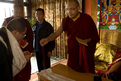 India - Sarnath - Disciples are given holy threads as a gift by The Karmapa Lama at the Vajra Vidya Institute for Buddhist st...